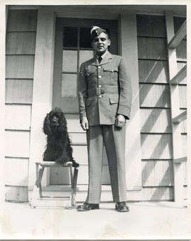 Photo: D.D. Bergie in RCAF Uniform Standing next to a Dog