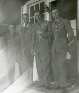 Photo: D.D. Bergie with Airmen and Civilian