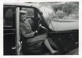 Photo: Woman and a Car