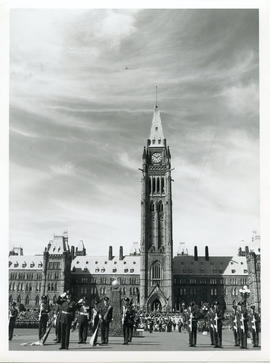 Photo: RCAF Servicemen Stand at Attention in front of Peace Tower