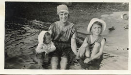 Photo: Woman in a Lake with Two Children