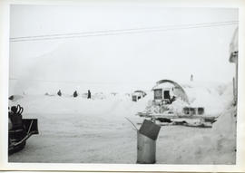 Photo: Arctic Scenery with Quonset Hut and Garbage Can