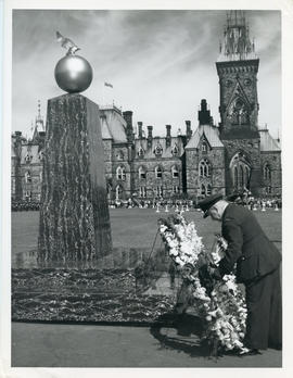 Photo: E.A. McNab Placing Wreath on Memorial