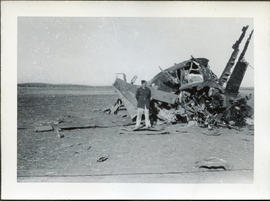 Photo: RCAF Airman in front of Wreck