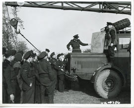 Photo: RCAF Personnel During Debriefing Outside on Truck