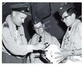 Photo: RCAF Officer with Air Cadets Inspecting Flight Helmet