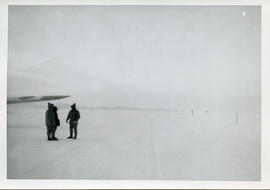 Photo: Arctic Runway with Three Men and Airplane Wing
