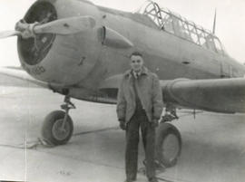 Photo: D.D. Bergie in Front of Harvard Aircraft